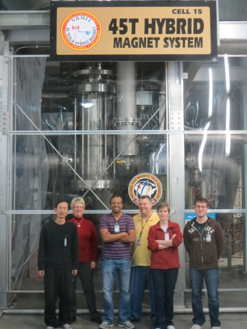 April 2013, Professor Musfeldt (second from left)'s group in front of 45T Hybrid Magnet System they used in research. Tatiana Brinzari (second from right). Their host/collaborator in NHMFL:  Steve McGill (third from right).