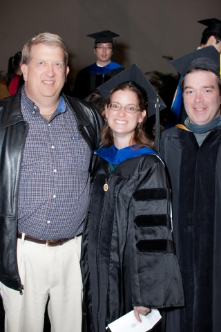 Dr. Jessica Gooding (center) with her father (left) and her mentor Professor Shawn Campagna (right) at her hooding ceremony.