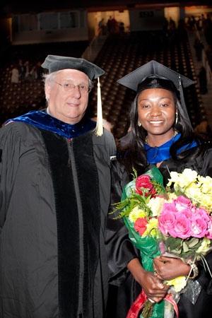 Irene Abia (right) and her mentor Professor David Baker (left) at 2011 December UT Graduate School Hooding Ceremony